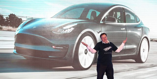 tesla ceo elon musk gestures during the tesla china made model 3 delivery ceremony in shanghai   tesla ceo elon musk presented the first batch of made in china cars to ordinary buyers on january 7, 2020 in a milestone for the companys new shanghai giga factory, but which comes as sales decelerate in the worlds largest electric vehicle market photo by str  afp  china out photo by strafp via getty images