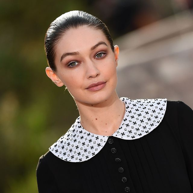 us model gigi hadid presents a creation by chanel during the womens spring summer 20202021 haute couture collection fashion show at the grand palais in paris, on january 21, 2020   the grand palais was turned into the garden of the cistercian abbey in aubazine, central france, where gabrielle coco chanel grew up photo by christophe archambault  afp photo by christophe archambaultafp via getty images