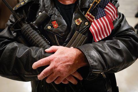 Leather, Jacket, Hand, Leather jacket, Textile, Finger, Glove, Gesture,