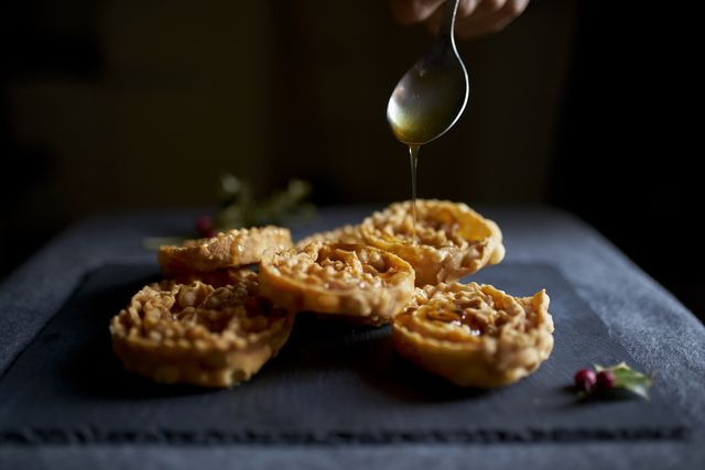 cartellate are crisp pastry spirals that are drizzled with honey or mosto cotto