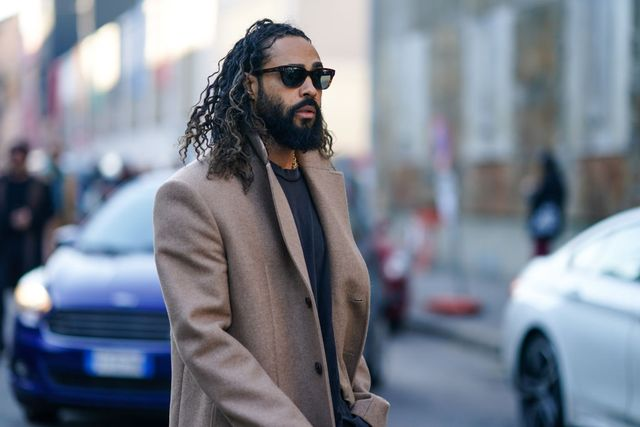 milan, italy   january 11  jerry lorenzo wears sunglasses, a beige long coat, a gray t shirt, outside marni, during milan fashion week fallwinter 20202021, on january 11, 2020 in milan, italy photo by edward berthelotgetty images