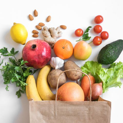 healthy food background healthy vegan vegetarian food in paper bag vegetables and fruits on white, copy space, banner shopping food supermarket and clean vegan eating concept