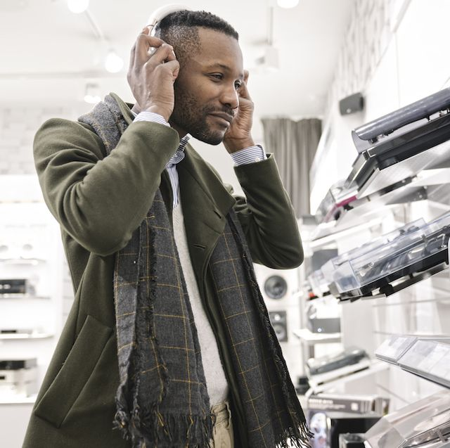 man trying headphones in a store