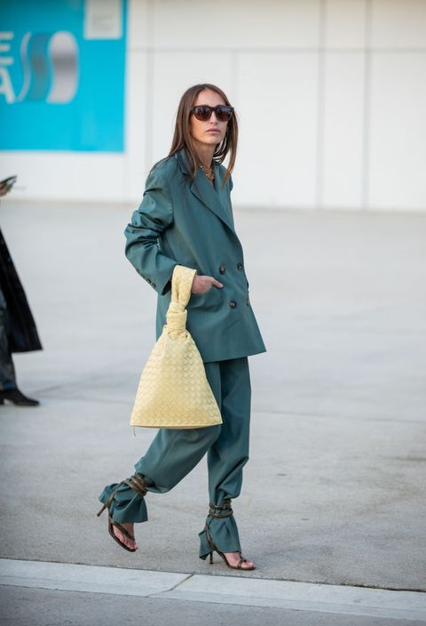 Clothing, Street fashion, Fashion, Coat, Fashion model, Outerwear, Snapshot, Footwear, Trench coat, Shoulder,