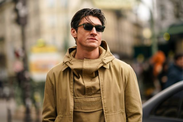 paris, france   january 19 a guest wears sunglasses, a napapijri sand color hooded top, a napapijri matched jacket,  outside paul smith, during paris fashion week   menswear fallwinter 2020 2021 on january 19, 2020 in paris, france photo by edward berthelotgetty images