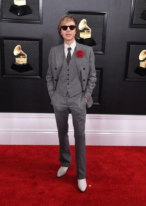 Suit, Red carpet, Clothing, Formal wear, Carpet, Tuxedo, Eyewear, Fashion, Blazer, Flooring,