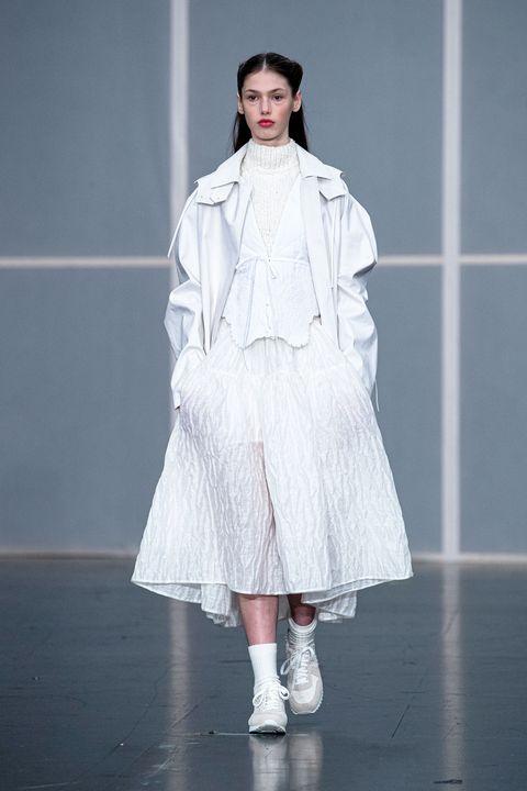 Fashion, Fashion model, Runway, Fashion show, Clothing, White, Haute couture, Shoulder, Fashion design, Outerwear,