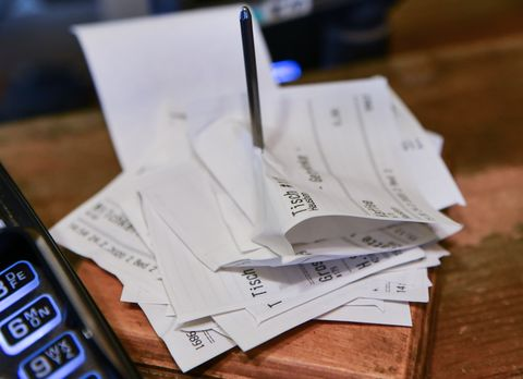 24 february 2020, berlin next to a cash register in a cafe, sales receipts are skewered photo jens kalaenedpa zentralbildzb photo by jens kalaenepicture alliance via getty images
