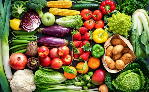 food background with assortment of fresh healthy organic fruits and vegetables on the table