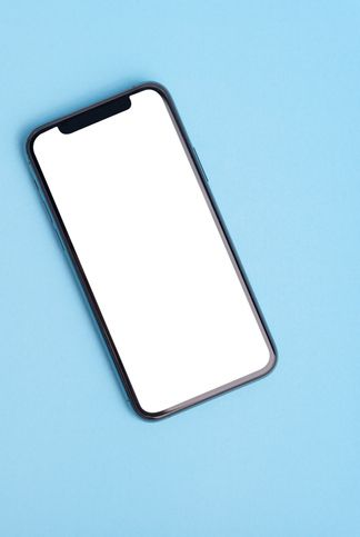 flat lay on blue workspace with cell phone gadget, blue textured office desk deadline concept copy space, background, top view