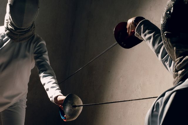 fencer woman with fencing sword fencers duel concept