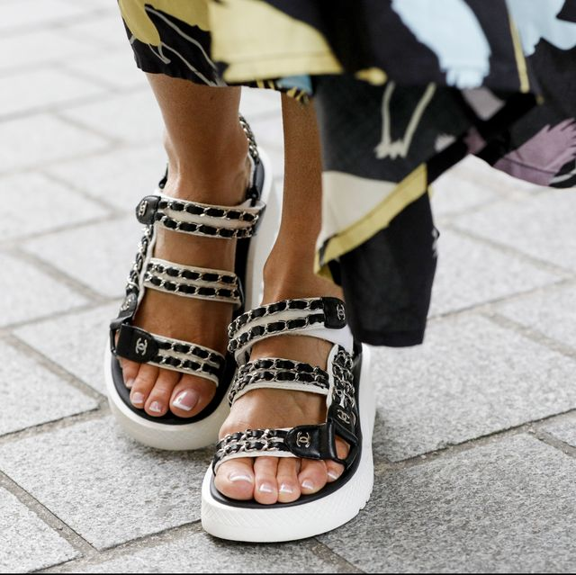 paris, france   february 29 the black and white leather chain trim sandales by chanel of influencer gitta banko as a detail during paris fashion week on february 29, 2020 in paris, france photo by isa foltingetty images