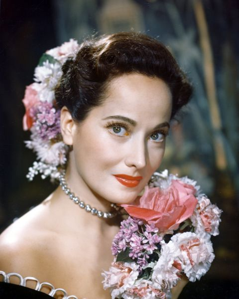 merle oberon 1911 1979, british actress, poses with a bouquet of flowers, with flowers in her hair, in a studio portrait, circa 1940 photo by silver screen collectiongetty images