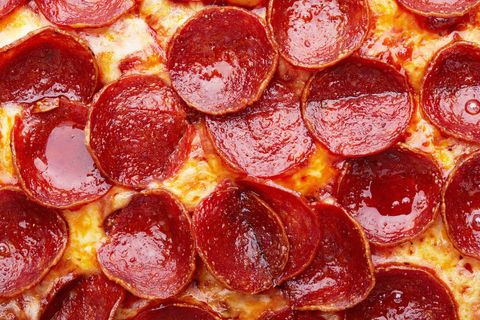 closeup of pepperoni pizza as a background