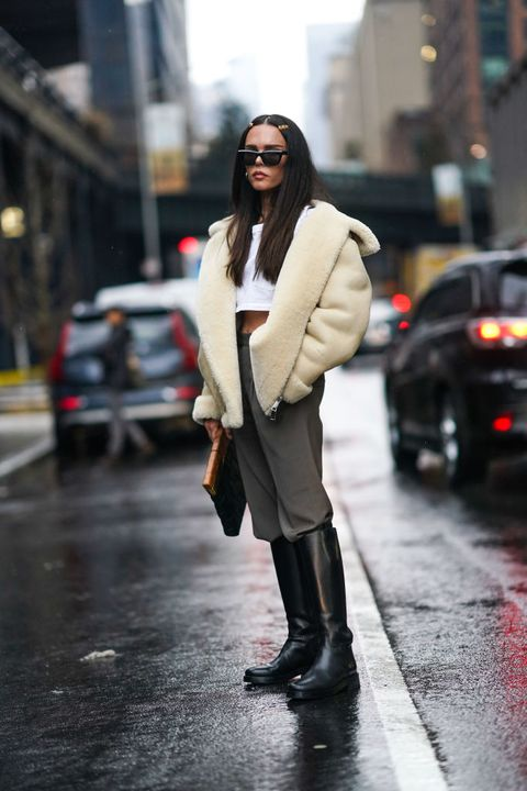 new york, new york   february 10 evangelie smyrniotaki wears hair brooches, a white wool fluffy coat, a white cropped top, black boots, during new york fashion week fall winter 2020, on february 10, 2020 in new york city photo by edward berthelotgetty images