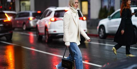 new york, new york   february 10 a guest wears a turtleneck pullover, a white jacket blue jeans, a bag, white leather pointy shoes, during new york fashion week fall winter 2020, on february 10, 2020 in new york city photo by edward berthelotgetty images