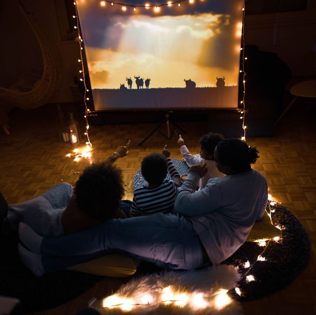 high angle view of relaxed african american family watching a movie in the living room
