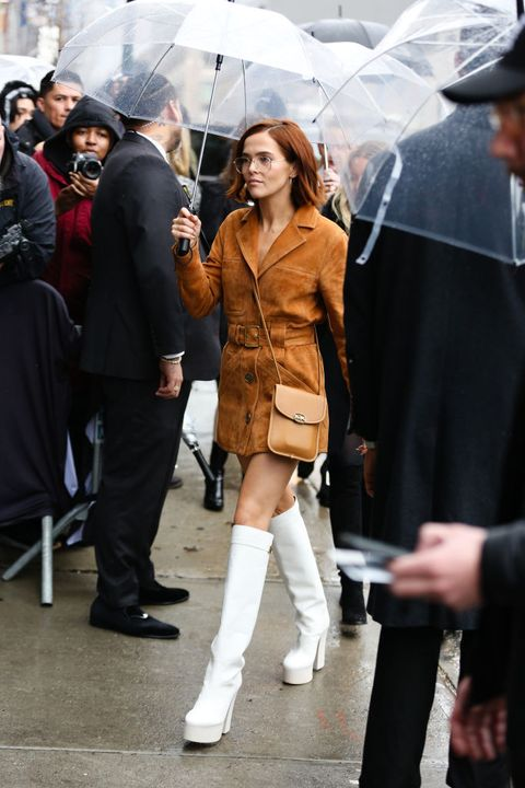 new york, new york   february 11 zoey deutch is seen wearing a tan dress and white knee high heels outside of the coach 1941 show during new york fashion week on february 11, 2020 in new york city photo by donell woodsongetty images