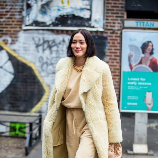 new york, new york   february 11 tiffany hsu is seen wearing yellow coat, beige pants and jumper, bottega bag outside gabriela hearst during new york fashion week fall  winter on february 11, 2020 in new york city photo by christian vieriggetty images