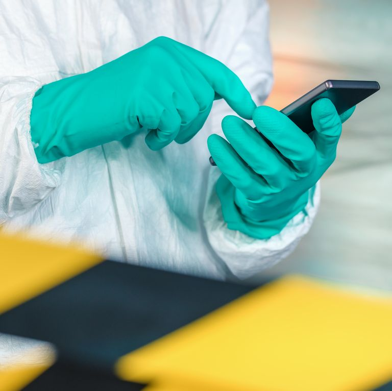 Epidemiologist using smartphone in Wuhan coronavirus quarantine