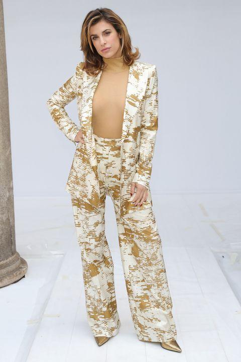 Clothing, Fashion model, Fashion, Pajamas, Outerwear, Leg, Dress, Fashion design, Suit, Sleeve,