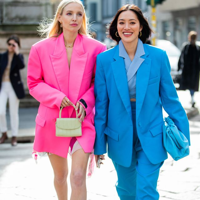 milan, italy   february 20 leonie hanne is seen wearing oversized pink vetements blazer, dress, grey mini bag and tiffany hsu wearing blue suit, outside pucci during milan fashion week fallwinter 2020 2021 on february 20, 2020 in milan, italy photo by christian vieriggetty images