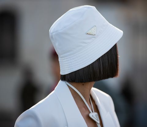 milan, italy   february 20 a guest is seen wearing bucket hat prada outside prada during milan fashion week fallwinter 2020 2021 on february 20, 2020 in milan, italy photo by christian vieriggetty images