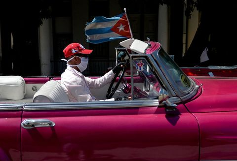 topshot   a private taxi driver on an old american car wears a face mask as a preventive measure against the spread of the new coronavirus, covid 19, while driving tourists around havana, on march 19, 2020 photo by yamil lage  afp photo by yamil lageafp via getty images