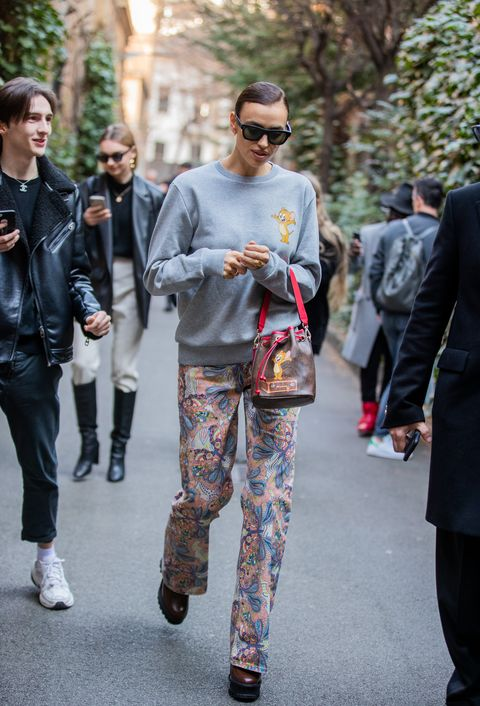 milan, italy   february 21 irina shayk is seen wearing grey jumper, pants with print bucket bag outside etro during milan fashion week fallwinter 2020 2021 on february 21, 2020 in milan, italy photo by christian vieriggetty images