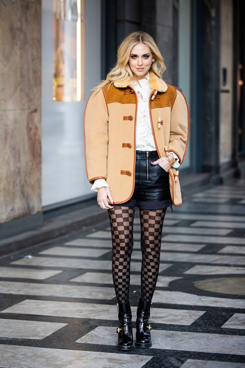 milan, italy   february 22 chiara ferragni, wearing oversize beige jacket, leather black shorts and calzedonia checked tights, is seen outside philosophy di lorenzo serafini show, during milan fashion week fallwinter 2020 2021 on february 22, 2020 in milan, italy photo by claudio laveniagetty images