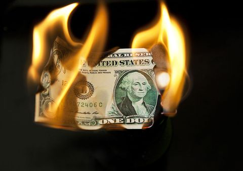 a burning us dollar bill, london, 8th august 2011 photo by tom stoddartgetty images