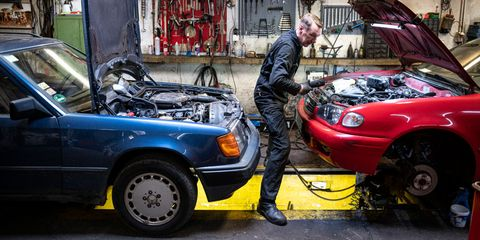 31 march 2020, berlin andreas lemmer, car mechanic and owner of his workshop, is working on a car photo fabian sommerdpa photo by fabian sommerpicture alliance via getty images