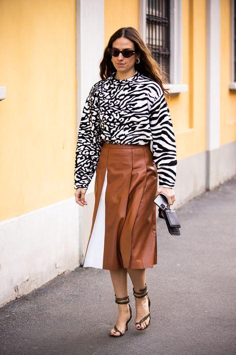 Clothing, Street fashion, White, Fashion, Eyewear, Footwear, Brown, Crop top, Shoulder, Outerwear,