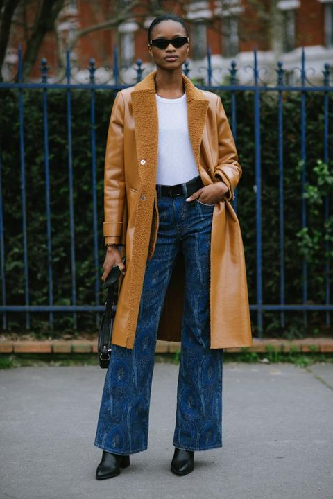 Clothing, Street fashion, Jeans, Fashion, Outerwear, Coat, Brown, Standing, Overcoat, Denim,