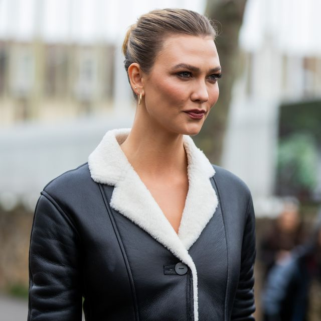 paris, france   february 28 karlie kloss is seen wearing black white shearling coat outside loewe during paris fashion week   womenswear fallwinter 20202021  day five on february 28, 2020 in paris, france photo by christian vieriggetty images