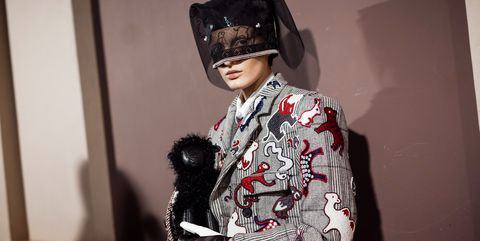 Fashion, Costume, Street fashion, Textile, Headgear, Fashion design, Photography, Fur, Black hair, Style,
