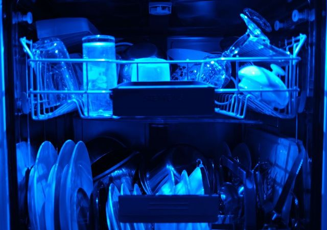 13 april 2020, north rhine westphalia, cologne washed dishes are in an open dishwasher with blue lighting photo oliver bergdpa photo by oliver bergpicture alliance via getty images