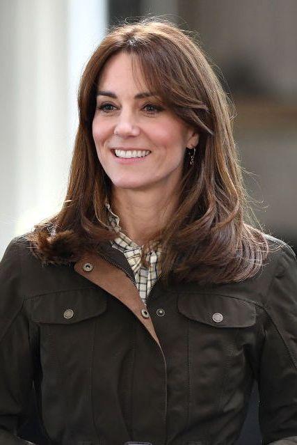 Hair, Jacket, Outerwear, Brown hair, Smile, Long hair, Layered hair,