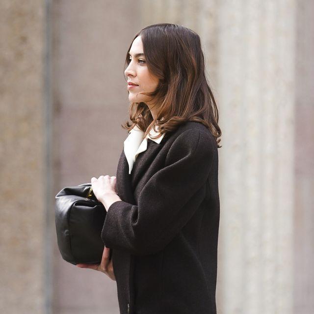 paris, france   march 03 alexa chung wears a black coat, a black bag, outside miu miu, during paris fashion week   womenswear fallwinter 20202021 on march 03, 2020 in paris, france photo by edward berthelotgetty images