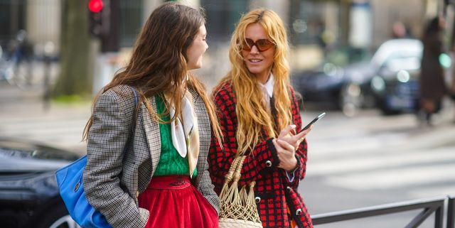paris, france   march 03 a guest l wears a blue bag, a checked oversized blazer jacket, a green wool pullover, a red skirt  blanca miro r wears a black and red checked wool jacket, a woven bag, sunglasses, outside miu miu, during paris fashion week   womenswear fallwinter 20202021 on march 03, 2020 in paris, france photo by edward berthelotgetty images