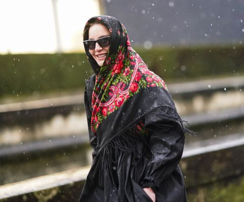 paris, france   march 01 ece sukan wears a colored floral print scarf over the head, sunglasses, a black long dress, outside valentino, during paris fashion week   womenswear fallwinter 20202021, on march 01, 2020 in paris, france photo by edward berthelotgetty images