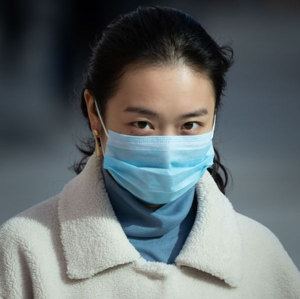 cardiff, united kingdom   march 08 a woman wears a surgical face mask as she walks in the street on march 8, 2020 in cardiff, united kingdom coronavirus covid 19 has spread to over 100 countries in a matter of weeks, claiming over 3,600 lives and infecting over 107,000 there are currently 273 diagnosed cases in the uk and two deaths photo by matthew horwoodgetty images