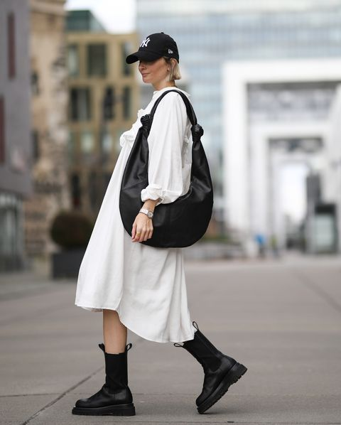 cologne, germany   march 07 kathrin bommann vivalawow wearing pixie shop dress, bottega veneta boots, frankie shop bag and, new era cap on march 07, 2020 in cologne, germany photo by jeremy moellergetty images