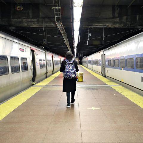 Commuters Navigate Mass Transit During Rush Hour Amid Coronavirus Threat