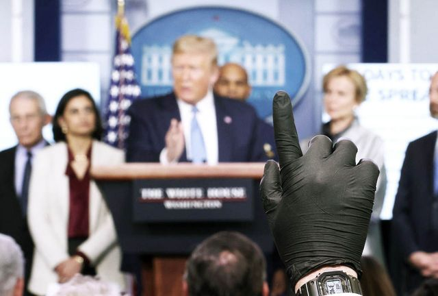 washington, dc   march 16 a reporter wearing a latex glove raises his hand to ask us president donald trump a question during coronavirus briefing at the white house on march 16, 2020 in washington, dc the united states has surpassed 3,000 confirmed cases of the coronavirus, and the death toll climbed to at least 61, with 25 of the deaths associated with the life care center in kirkland, washington photo by win mcnameegetty images