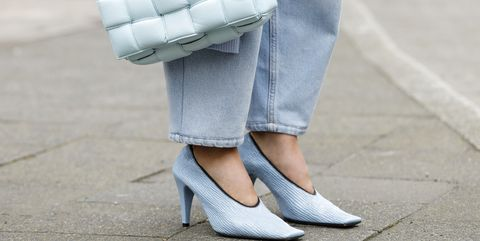 duesseldorf, germany   march 19 a jeans by magda butrym, a pastel blue cardigan by t7berlin, a topaz colored padded cassette bag and topaz colored crunch sharpei pumps by bottega veneta as a detail of influencer gitta banko during a street style shooting on march 19, 2020 in duesseldorf, germany photo by isa foltingetty images