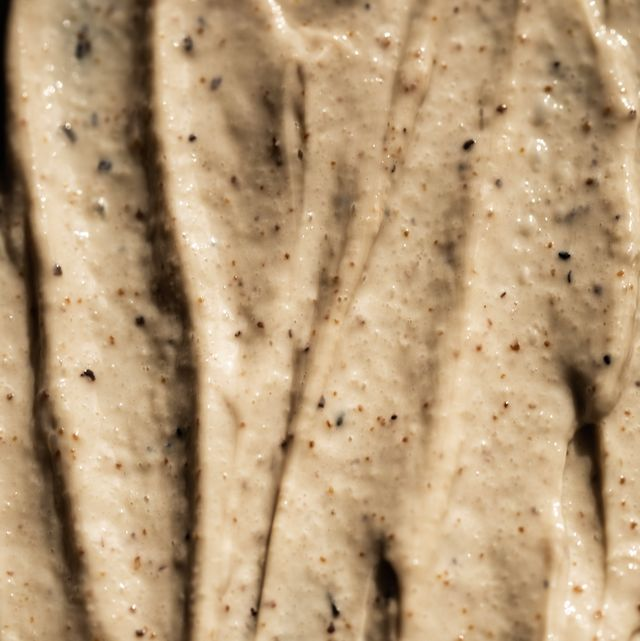 cosmetic cream scrub texture on black background scrub for face and body with coffee and honey organic and beauty concept