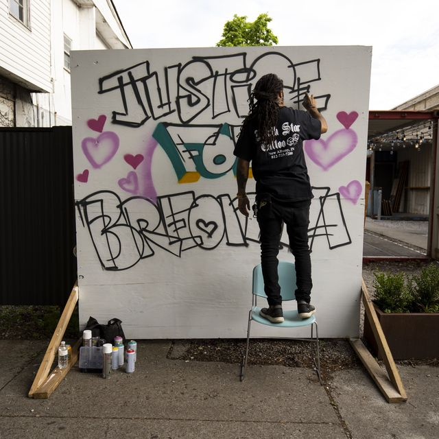 """louisville, ky   may 29  grafitti artist """"resko"""" paints a mural near the march's start on may 29, 2020 in louisville, kentucky protests have erupted after recent police related incidents resulting in the deaths of african americans breonna taylor in louisville and george floyd in minneapolis, minnesota photo by brett carlsengetty images"""