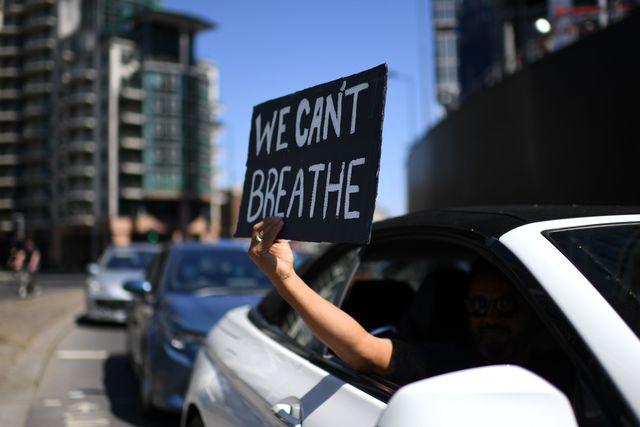 topshot   a sign displaying the message we cant breathe is held out of a car window as demonstrators make their way towards the us embassy in central london on may 31, 2020 to protest the death of george floyd, an unarmed black man who died after a police officer knelt on his neck for nearly nine minutes during an arrest in minneapolis, usa   hundreds of people gathered in central london to protest the death of george floyd, an unarmed black man who died while being arrested in minneapolis, usa photo by daniel leal olivas  afp photo by daniel leal olivasafp via getty images