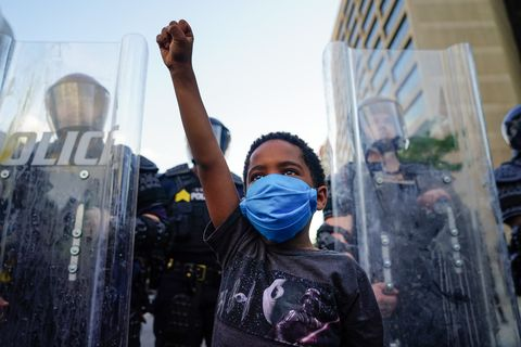 atlanta, ga   may 31 a young boy raises his fist for a photo by a family friend during a demonstration on may 31, 2020 in atlanta, georgia across the country, protests have erupted following the recent death of george floyd while in police custody in minneapolis, minnesota photo by elijah nouvelagegetty images
